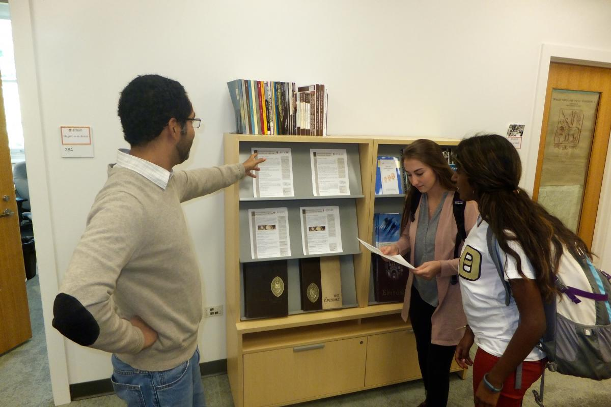 Prof Hugo Ceron Anaya with students in the department's main office