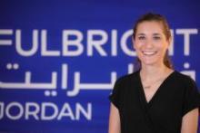 "Photo of Allison Mickel in front of ""Fulbright Jordan"" banner"