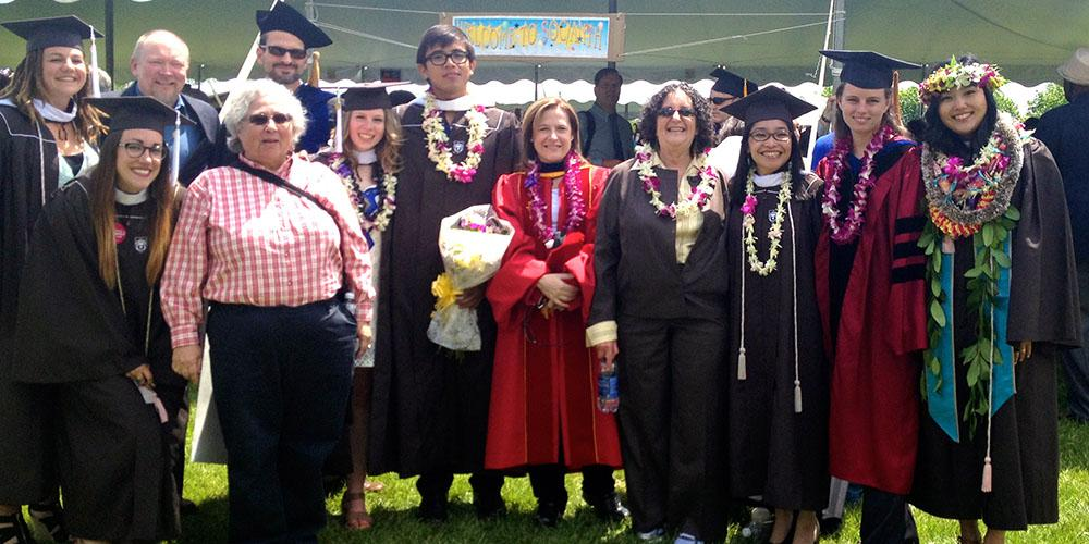 Department faculty with new graduates, May 2014